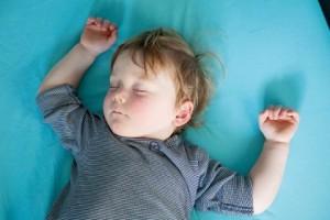 a little boy sleeps comfortably