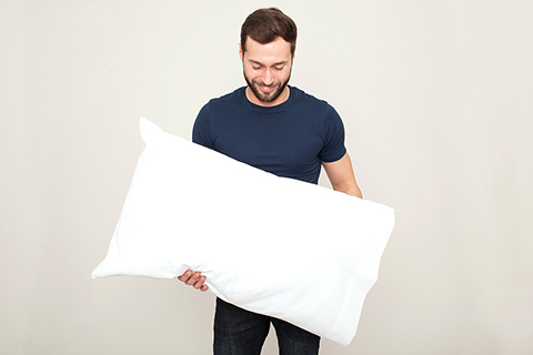 Man Holding Neck Pillow