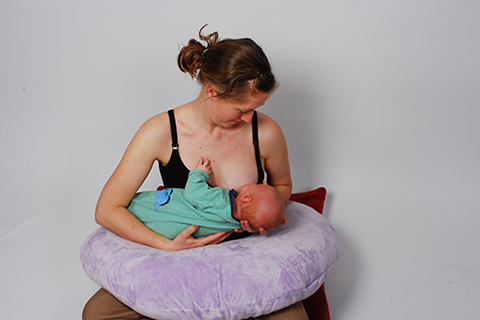 Women Breastfeeding a Child Using Pillow