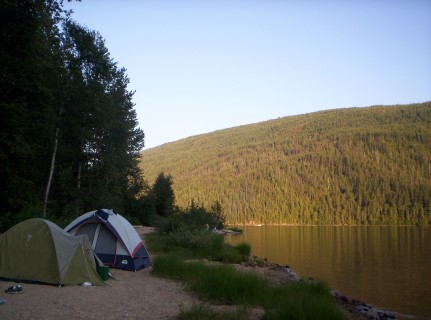 tents by a lake