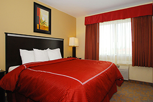 A wonderful bed frame with red bed sheet.