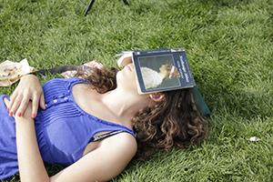 Woman sleeping in the open field.